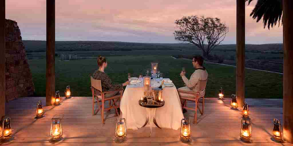 kwandwe fort house couple dining