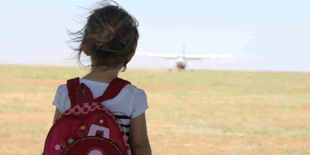 Family experience young girl watching plane arrive