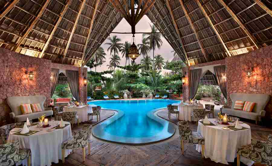 xandu villas poolside dinner tanzania yellow zebra safaris